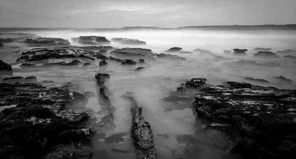 Long daytime exposure of the sea against rocks