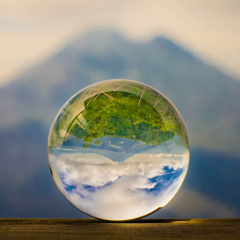 Volcano Gunung Batur on the island of Bali refracted through a glass sphere
